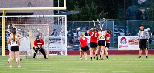 #00 Andrea Apadoca, one of San Clementes two goalies traps a penalty shot from Laguna Hills.