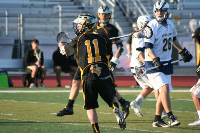 Carter Bache (11) winds up