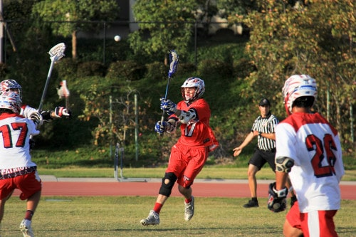 Clay Peters feeds an attackman coming around the cage